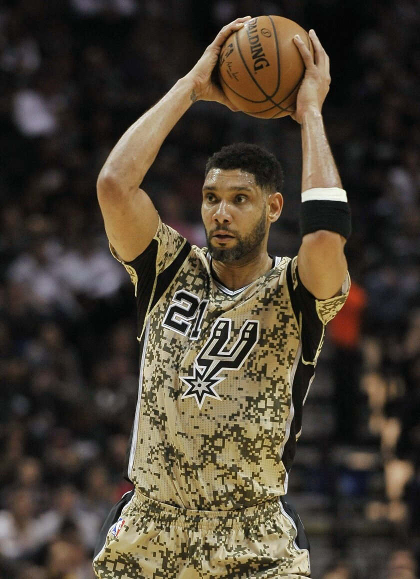 San Antonio Spurs forward Tim Duncan looks to pass during the first half of an NBA basketball game against the Denver Nuggets, Friday, March 6, 2015, in San Antonio. (AP Photo/Darren Abate)