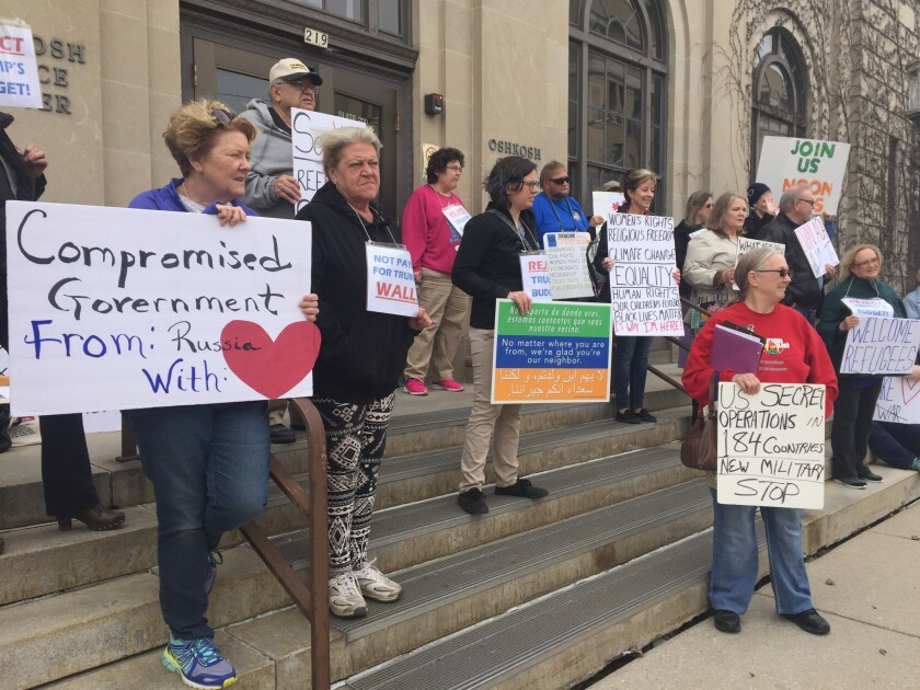 Resisters gather for a weekly protest outside GOP Sen. Ron Johnson's office in Oshkosh, Wis.