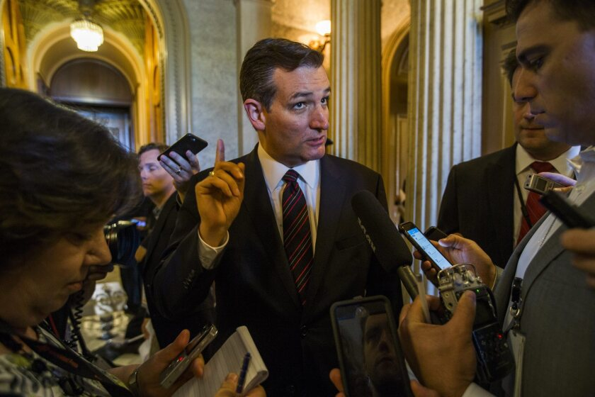 Sen. Ted Cruz (R-Texas) speaks to the media after the Senate voted against his motion on the highway bill in Washington.