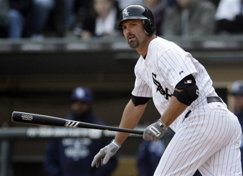 Chicago White Sox's Paul Konerko watches his double against the Tampa Bay Rays during the fourth inning of a baseball game in Chicago, Saturday, April 9, 2011. (AP Photo/Nam Y. Huh)