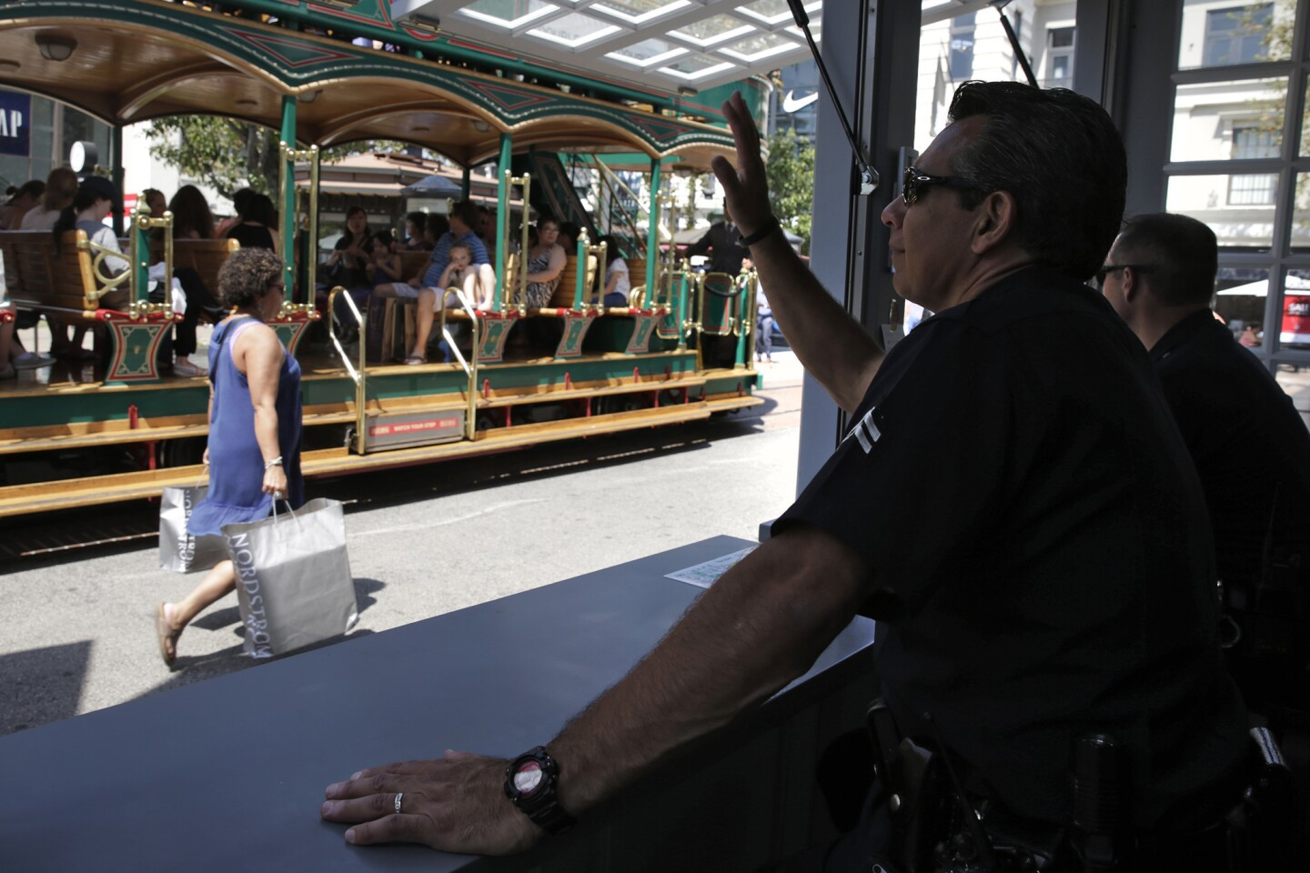 Los Angeles Police Officers Michael Acosta, left, and Thomas McClaughlin watch over the Grove shopping center from a police kiosk.