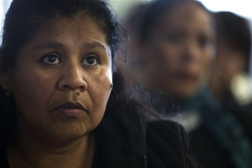 """Adelfina Guzman listens along with immigration advocates to President Barack Obama's speech on immigration reform, Tuesday, Jan. 29, 2013, in San Diego. The President on Tuesday praised bipartisan efforts to overhaul the nation's immigration laws, welcoming """"a genuine desire"""" to tackle a famously s"""