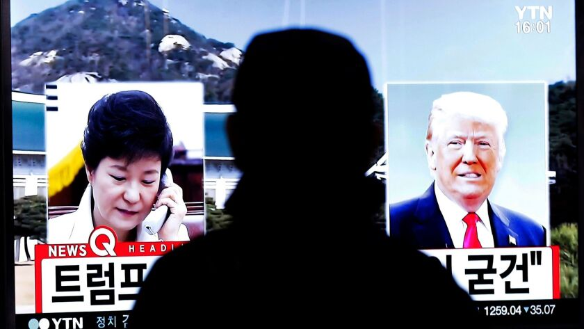 At the Seoul Railway Station, a man watches a report about South Korean President Park Geun-hye  and U.S. President-elect Donald Trump on Nov. 10, 2016.