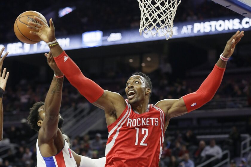 FILE - In this Nov. 30. 2015, file photo, Houston Rockets center Dwight Howard (12) and Detroit Pistons center Andre Drummond reach for the rebound during the first half of an NBA basketball game, in Auburn Hills, Mich. Last year there was hardly any action in the days leading up to the NBA's tradi