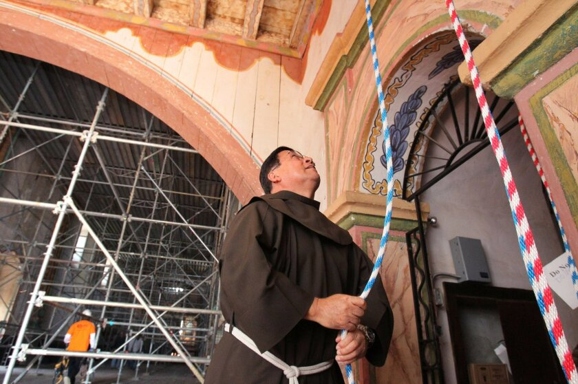 Father Arturo Lopez, originally from Mexico City, rings the bell at the Mission San Luis Rey's Church, currently undergoing an earthquake retrofit, in celebration of the Vatican's announcement today of a new Pope, Jorge Mario Bergoglio of Argentina, who will be known as Pope Francis I. Arturo is ve
