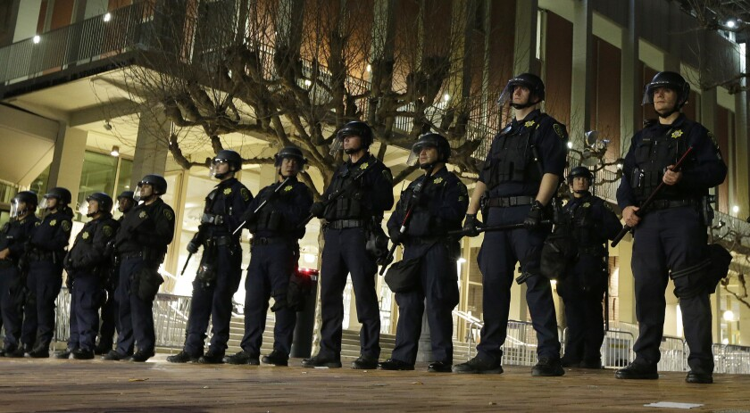 UC Berkeley police officers guard the building where then-Breitbart News editor Milo Yiannopoulos was to speak in February 2017. The speech was canceled.