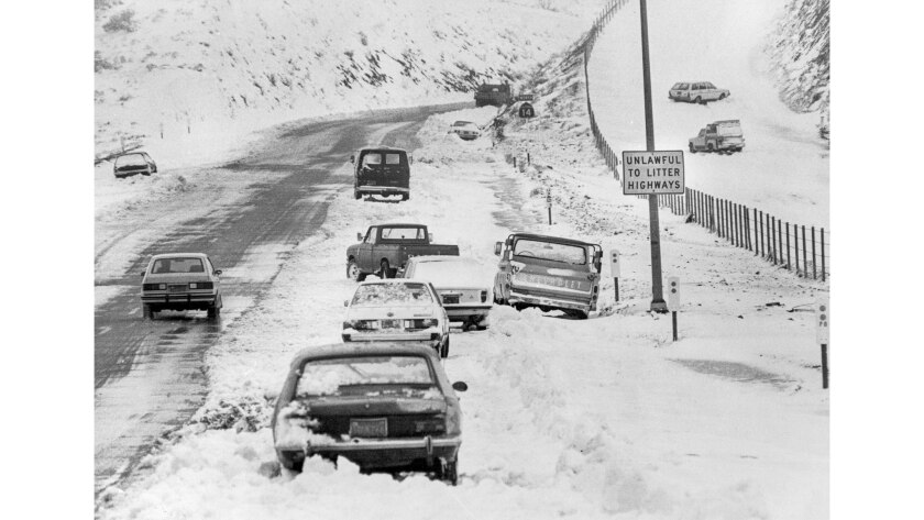 Feb. 3, 1983: After a winter storm, cars without chains sit abandoned along Interstate 14 seven miles south of Palmdale.
