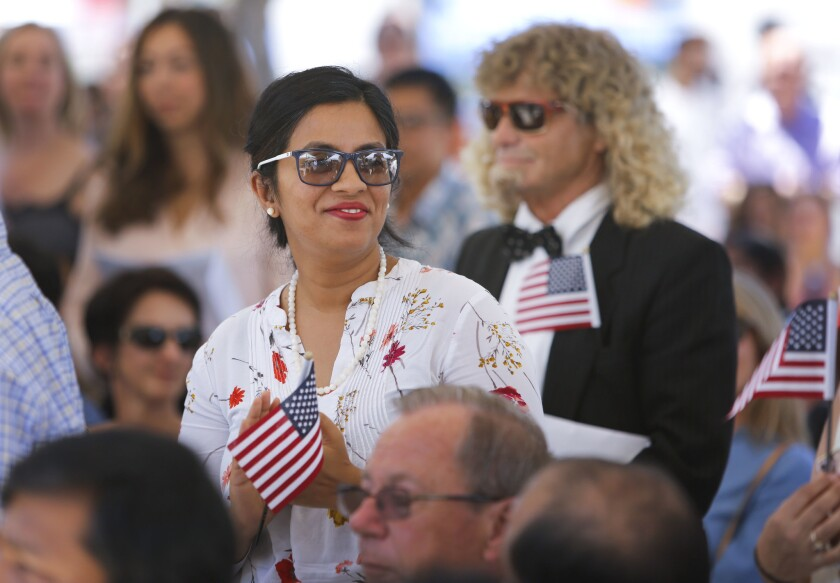 About 100 people from about 54 countries took the Oath of Allegiance to the United States of America and became U.S. citizens during a naturalization ceremony held in Centennial Plaza near El Cajon City Hall to kickoff El Cajon's, America on Main Street festivities.