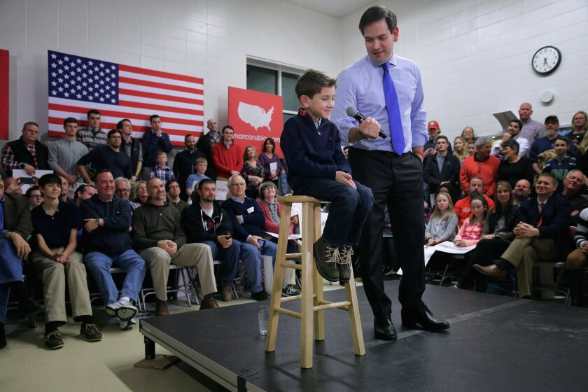Dominick Rubio, 7, joins his father Marco Rubio on stage during a campaign town hall event at Mary A. Fisk Elementary School in Salem, N.H. Feb. 4.