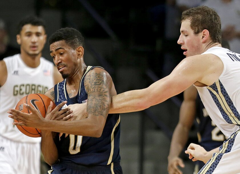 Notre Dame's Eric Atkins, left, steals the ball from Georgia Tech's Daniel Miller, right, in the first half of an NCAA college basketball game, Saturday, Jan. 11, 2014, in Atlanta. (AP Photo/David Goldman)