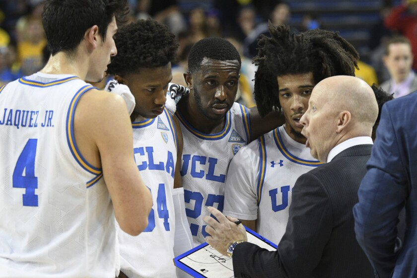 UCLA head coach Mick Cronin talks with Jaime Jaquez Jr., David Singleton, guard Prince Ali and Tyger Campbell, from left, during a timeout against Colorado on Jan. 30 at Pauley Pavilion.