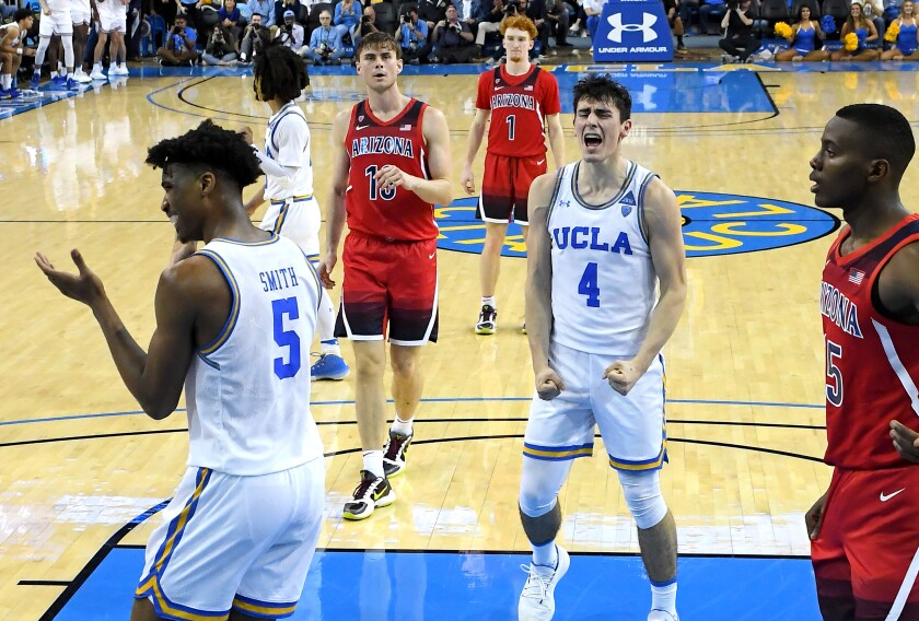 UCLA's Chris Smith, left, and Jaime Jaquez Jr. react to a blocked shot during the Bruins' win over Arizona on Saturday.