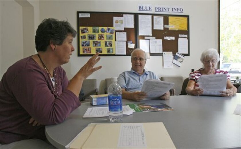 In this photo taken on Tuesday, Sept. 22, 2009, Nurse Pam Farnham, left, talks with Del Carpenter and his wife, Sandy, from Colchester, Vt., in South Burlington, Vt. The Blueprint for Health uses so-called Community Care Teams to complement the work of primary-care physicians by offering follow-up services from nurses, nutritionists, dieticians, trainers and social workers. (AP Photo/Toby Talbot)