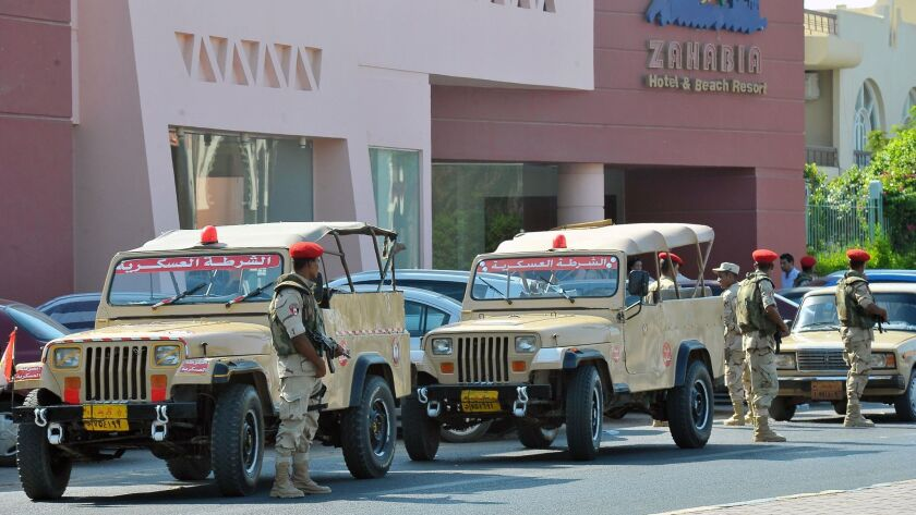 Egyptian military personnel in front of one of two beach resorts where a stabbing attack occurred.