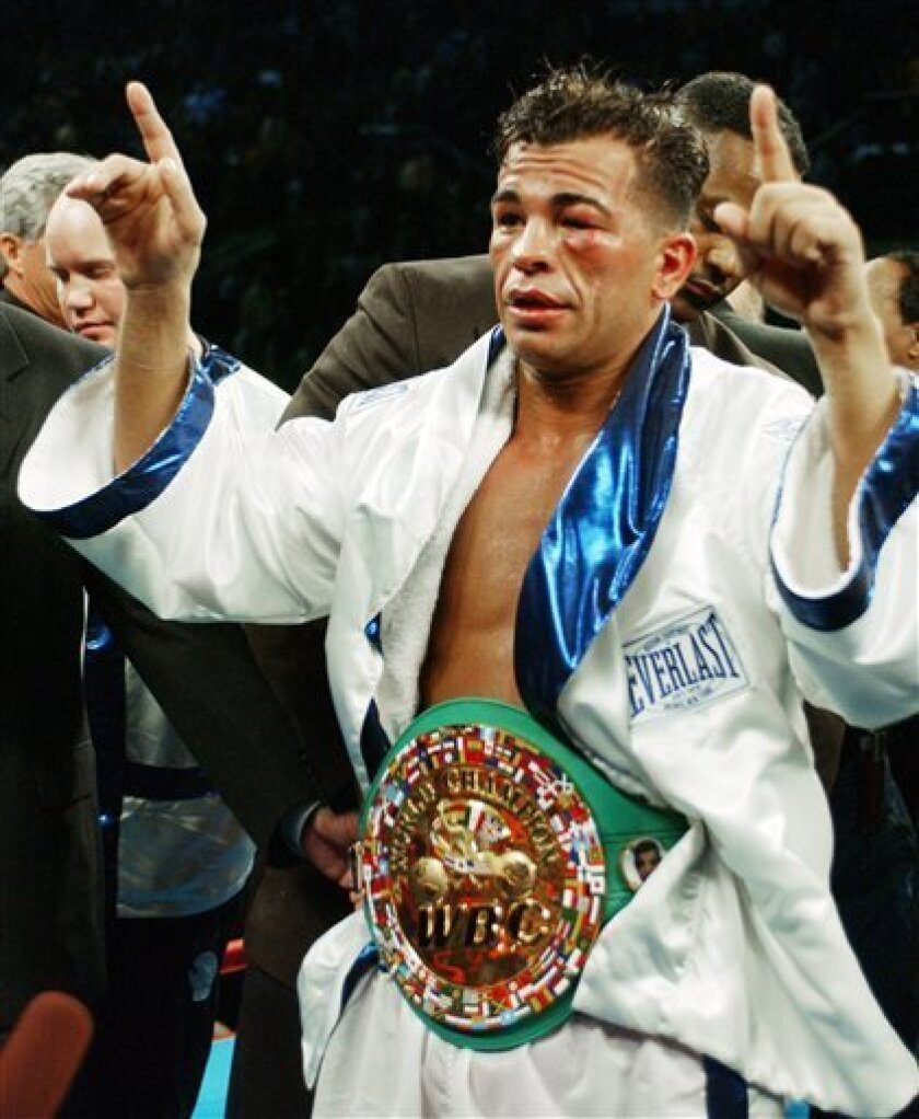 FILE - In this Jan. 24, 2004 file photo, Arturo Gatti celebrates after defeating Gianluca Branco of Italy for the WBC junior welterweight championship in Atlantic City, N.J. Officials say Gatti has been found dead in a hotel room at the seaside resort of Porto de Galinhas in northeastern Brazil on Saturday, July 11, 2009, where he arrived on Friday with his wife and one-year-old son. The spokesman said it was unclear how Gatti died. He was 37. (AP Photo/Mary Godleski)