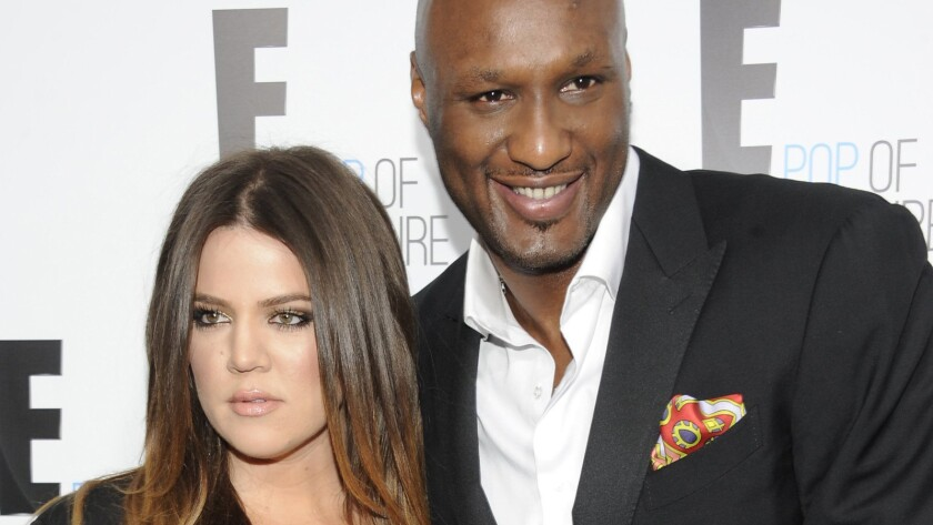 """Khloe Kardashian and Lamar Odom, from the show """"Keeping Up With the Kardashians,"""" attend an E! Network upfront event in 2012 at Gotham Hall in New York."""