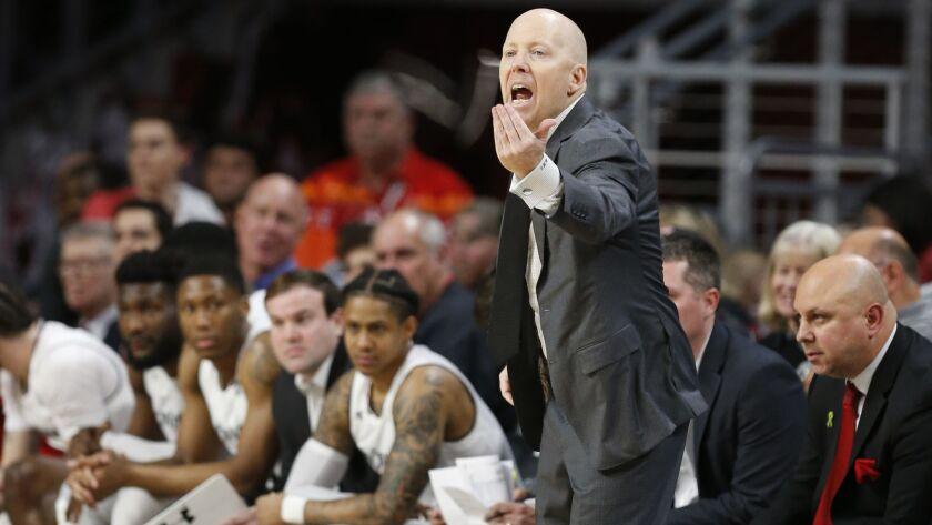 Cincinnati head coach Mick Cronin works the floor during the second half of an NCAA college basketba