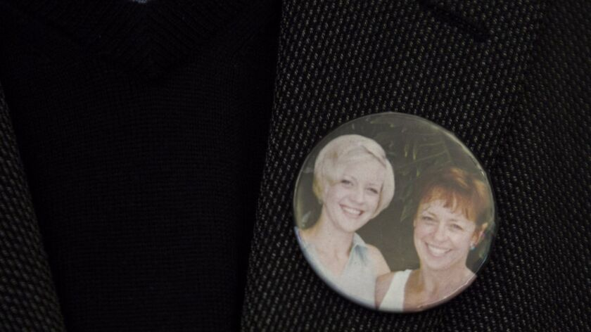 Alan Sudweeks wears a pin on his lapel with a picture of his ex-wife, Sandy, and their daughter, Sunny, who was raped and killed in 1997.