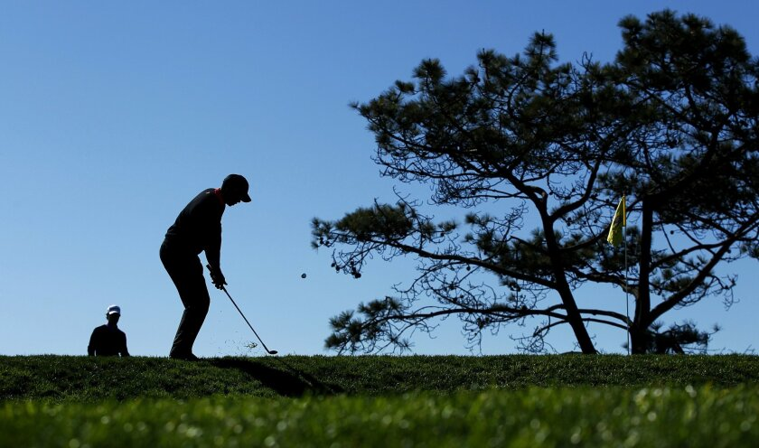 Tiger Woods chips on the 12th hole at Torrey Pines