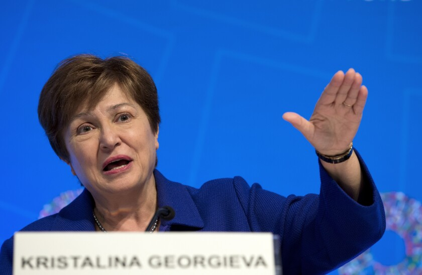 FILE - In this Oct. 19, 2019 file photo, International Monetary Fund Managing Director Kristalina Georgieva speaks during a news conference after the International Monetary and Financial Committee (IMFC) meeting, at the World Bank/IMF Annual Meetings in Washington. Georgieva says the agency is trimming its forecast for global growth this year. On Tuesday, Oct. 5, 2021 Georgieva cited rising risks of inflation, debt and a divergence in growth prospects between nations with access to the coronavirus vaccines and those in need of shots. (AP Photo/Jose Luis Magana, File)