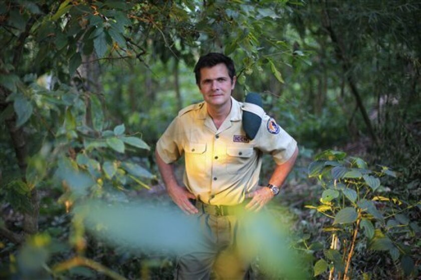 In this picture taken Wednesday Aug. 11, 2012, Emmanuel de Merode, Virunga National Park director and chief warden poses at the park headquarters in Rumangabo, some 60 kms (40 miles) north of Goma, eastern Congo. Virunga National Park, where virtually every rebellion in eastern Congo in the past 30 years has started, and its endangered mountain gorillas, are facing increasing threats from a new rebel group and from a decision to open Africa's oldest national park to oil exploration.Virunga now has about a quarter of the world's remaining 790 mountain gorillas, with the others concentrated in parks in neighboring Rwanda and Uganda. (AP Photo/Jerome Delay)