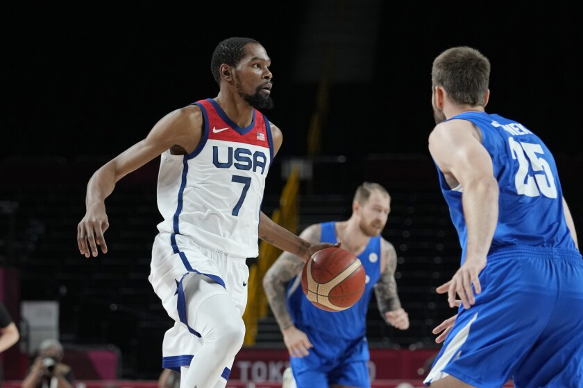 U.S. forward Kevin Durant, left, brings the ball up court during a 119-84 victory over the Czech Republic.