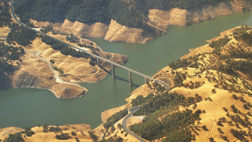 In a lawsuit, the federal government says California's new flow standards for the Stanislaus River will interfere with operation of the New Melones Dam and reservoir.