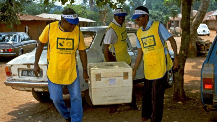 Global Eradication of Polio Initiative workers and volunteers deliver vaccination doses to a village