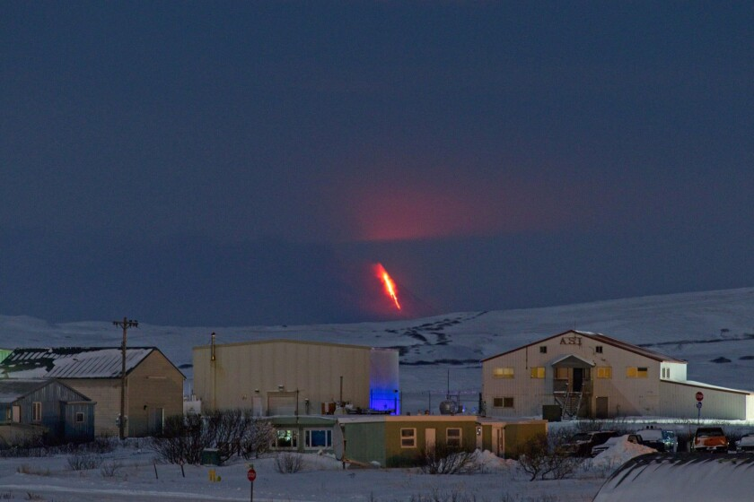This Monday, Jan. 6, 2020, photo provided by Aaron Merculief shows lava flowing from a vent on the Shishaldin Volcano, as seen from Cold Bay, Alaska about 58 miles North East of Shishaldin. The volcano, in Alaska's Aleutian Island erupted at 5 a.m. Tuesday. A few hours later, another eruption pushed an ash cloud to 25,000 feet, and the National Weather Service issued a warning for passing aircraft. Seismicity significantly decreased after noon. (Aaron Merculief via AP)