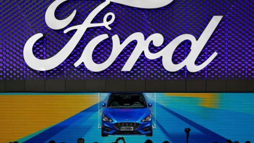 A Ford Focus is displayed April 25, 2018, at the Ford exhibit at the China Auto Show in Beijing. The carmaker has reorganized its Asian operations and hired industry veteran Chen Anning to run its China business.