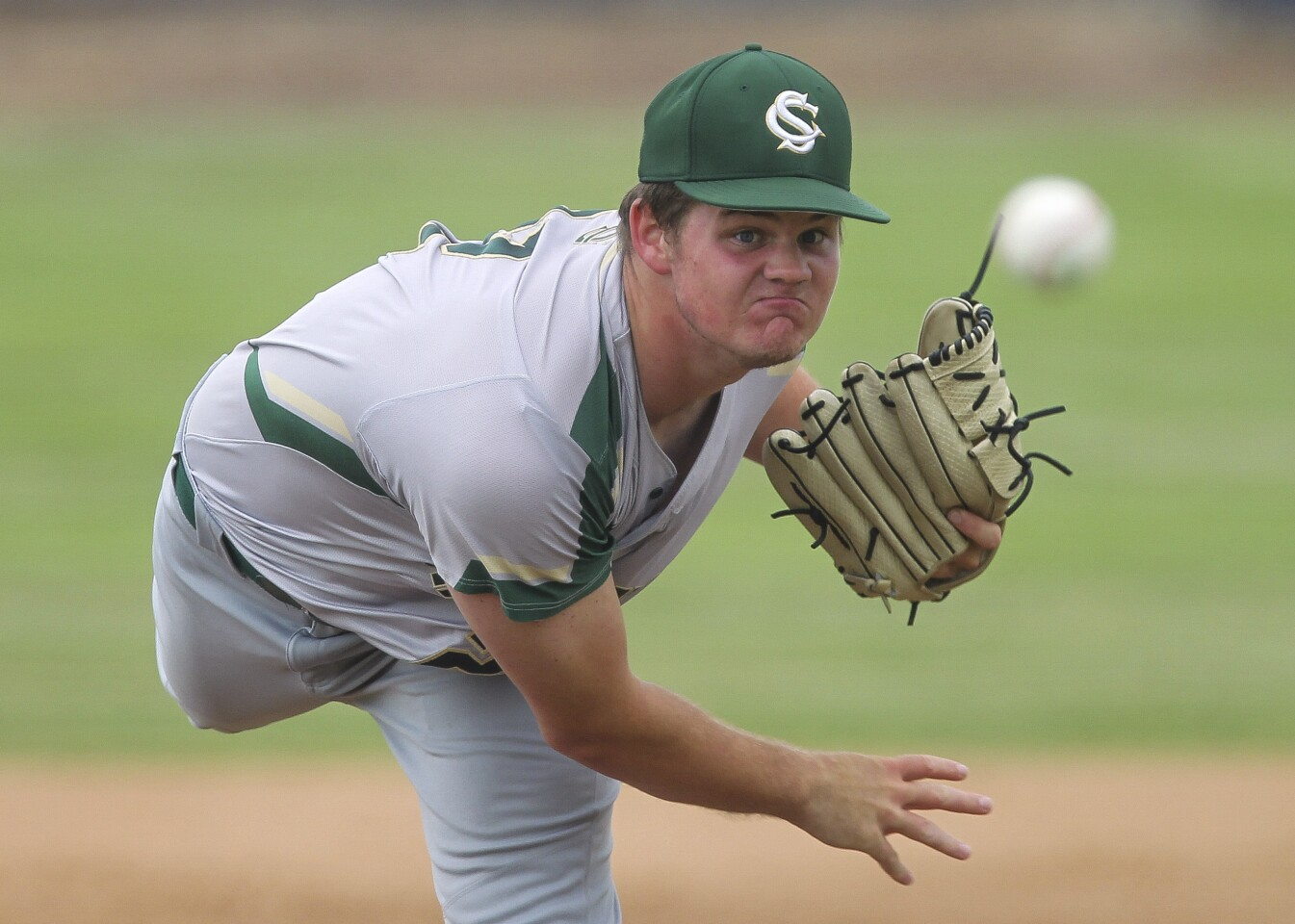 Sage Creek's Stephen Klenske pitches to San Dieguito Academy in the first inning.