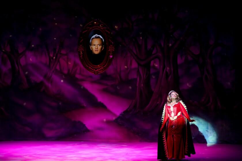 "Neil Patrick Harris (as the Magic Mirror) and Yvette Cason in ""A Snow White Christmas."""