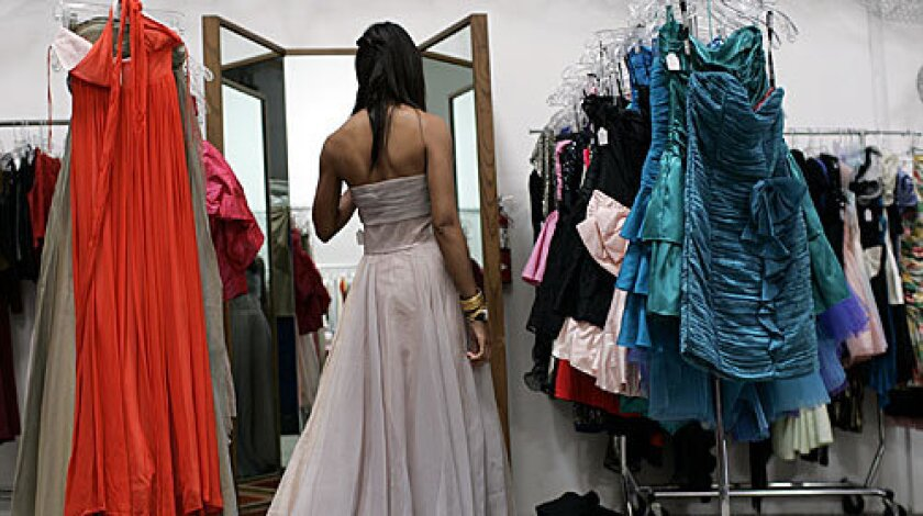 YES, BUT: A light gray strapless has the bohemian look Wells Butler seeks, but she worries it's too much like her wedding dress.