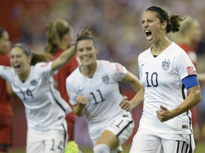 Carli Lloyd celebrates after scoring against Germany on a penalty kick during a semifinal match of the Women's World Cup. The U.S. beat Germany, 2-0.