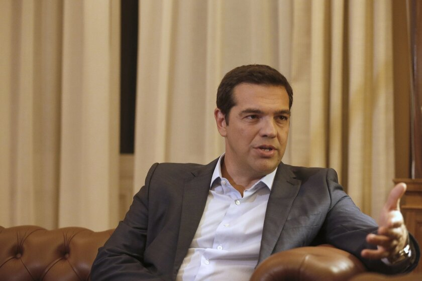 Greek Prime Minister Alexis Tsipras, meets with Greek President Prokopis Pavlopoulos, in Athens, Thursday, Aug. 20, 2015. Tsipras announced his government's resignation and called early elections Thursday, seeking to consolidate his mandate to implement a new three-year international bailout that s