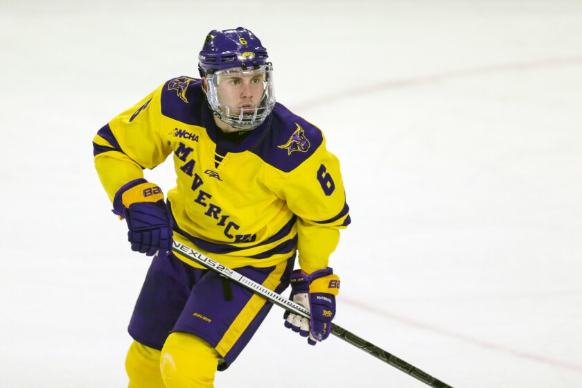 FILE - Minnesota State's Parker Tuomie skates against Bemidji State during an NCAA hockey game in Mankato, Mich., in this Friday, March 1, 2019, file photo. While major leagues mostly managed to make a season out of the pandemic, scores of athletes on the lower-profile levels of sports temporarily lost the chance to compete because of the COVID-19 outbreak. Parker Tuomie and the Minnesota State hockey team had their chase for the program's first NCAA championship ended abruptly a year ago. Tuomie, a native of Germany, now plays professionally in Berlin. (AP Photo/Andy Clayton-King, File)