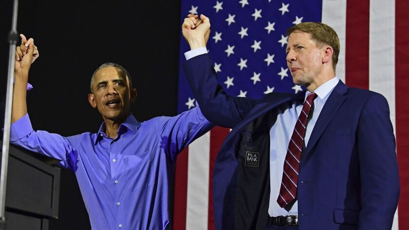 Former President Barack Obama, left, and Democratic gubernatorial candidate Richard Cordray at a cam