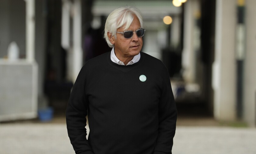 Trainer Bob Baffert looks out from his barn at Churchill Downs.