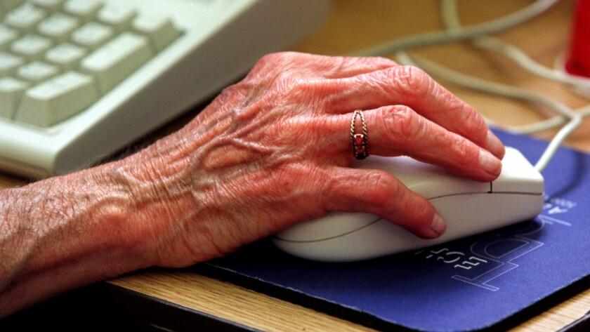 Senior citizen using a computer