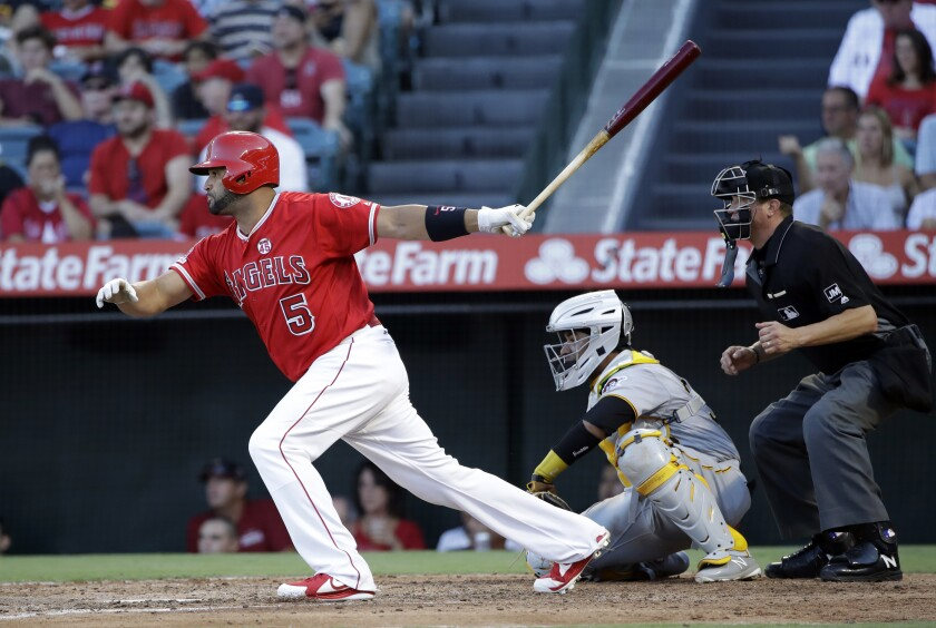 Angels' Albert Pujols singles in a run against the Pittsburgh Pirates during the fourth inning.