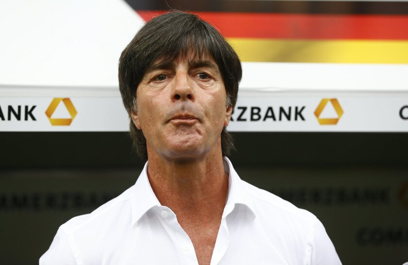FILE - In this Sunday, May 29, 2016 file photo, Germany head coach Joachim Loew watches a friendly soccer match between Germany and Slovakia in Augsburg, Germany. (AP Photo/Matthias Schrader)