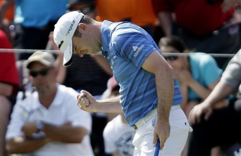 Martin Laird, of Scotland, pumps his fist after a birdie on the 16th hole during the final round of the Texas Open golf tournament on Sunday, April 7, 2013, in San Antonio. Laird won the tournament. (AP Photo/Eric Gay)