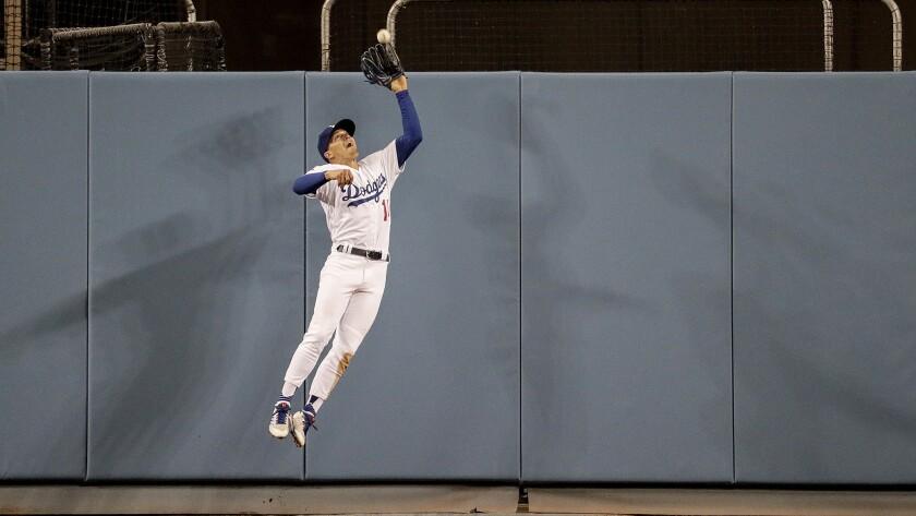 LOS ANGELES, CA, SUNDAY, APRIL 1, 2018 - Dodgers centerfielder Enrique Hernandez makes a leaping cat