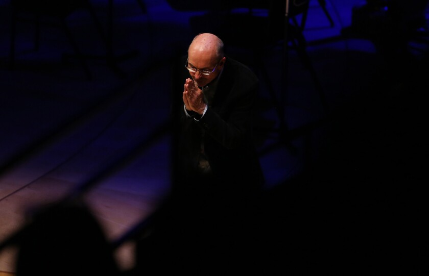 """Bill Viola takes a bow after his video and sound installation """"Inverted Birth"""" was shown at Walt Disney Concert Hall."""