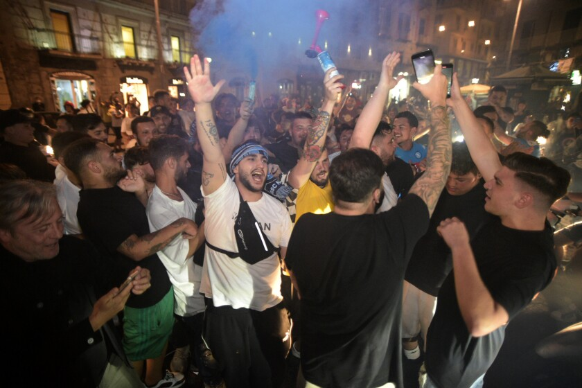 Napoli fans celebrate their team's win over Juventus in the Italian Cup soccer final against Juventus, in Naples, Italy, Wednesday, June 17, 2020. Napoli won the Italian Cup with a 4-2 penalty shootout victory over Juventus following a 0-0 draw in a match played at the Rome Olympic Stadium. (Alfredo Falcone/LaPresse via AP)
