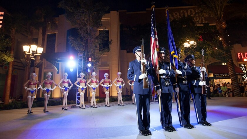 In an only-in-Vegas scene, soldiers and showgirls take to the stage together during an Independence Day celebration at the Linq Promenade.