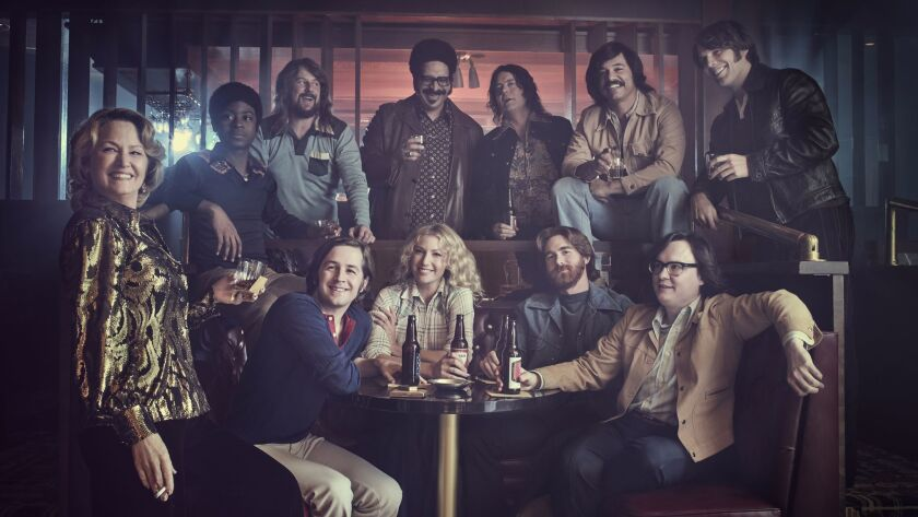 """The cast of """"I'm Dying Up Here."""" Standing from left: Melissa Leo, RJ Cyler, Stephen Guarino, Erik Griffin, Jon Daly, Al Madrigal and Jake Lacy. Seated from left: Michael Angarano, Ari Graynor, Andrew Santino and Clark Duke."""