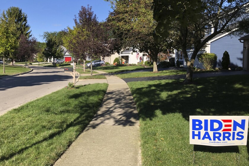 A Biden for President sign in a lawn of suburban Dublin, Ohio, on Friday, Sept. 18, 2020. In the campaign for House control, some districts are seeing a fight between Democrats saying they'll protect voters from Republicans willing to take their health coverage away, while GOP candidates are raising specters of rioters imperiling neighborhoods if Democrats win. (AP Photo/Julie Carr Smyth)