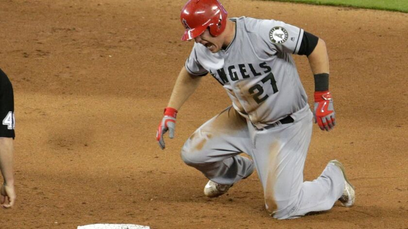 Los Angeles Angels' Mike Trout (27) reacts after stealing second during the fifth inning of an inter