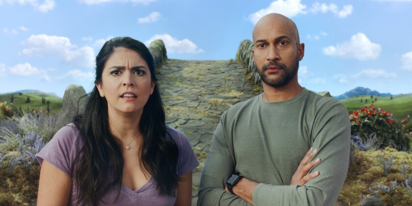 Cecily Strong and Keegan-Michael Key with a fantasy-world stone footbridge behind them.